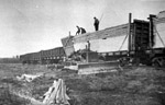 Unloading Prefabricated Bunkhouses (1945)