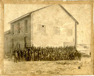 Workers in front of Building at Sulphide Mine