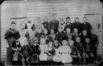 Lucy Maud Montgomery with pupils of Belmont School, ca.1897.  Belmont, P.E.I.