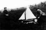 2 (unidentified) boys playing with sailboat, ca.1880's.  Cavendish, P.E.I.