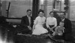 Rev. John Stirling, Margaret Ross Stirling, Mabel Simpson McIntosh, Rev. Major Hooper McIntosh & baby Douglas McIntosh.  Cavendish Manse, 1910.