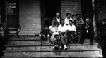 Group on porch at Roselawn with Chester, Stuart & Ewan Macdonald, ca.1920.  Bala. ON.