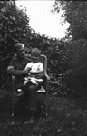 Lucy Maud Mongomery's step brother Carl - son of H.J. Montgomery & 2nd wife - seen holding Stuart, ca.1918.  Leaskdale, ON.