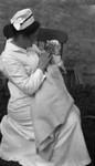 Nurse Bernard (?) with newborn Stuart, ca.1915.  Leaskdale, ON.