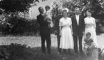 Unidentified man holding Stuart, Ewan, Miss Fraser, Mrs. Fraser, Lucy Maud Montgomery and Chester, ca.1920.  Leaskdale, ON.