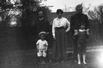 Ewan, Chester, Stuart and Mr. & Mrs. Dodds (good friends), ca.1919.  Leaskdale, ON.