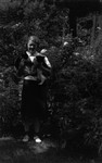 Unidentified young woman holding 2 cats, ca.1940 (?).  Toronto, ON.