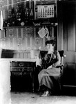 Lucy Maud Montgomery seated in kitchen of Leaskdale Manse