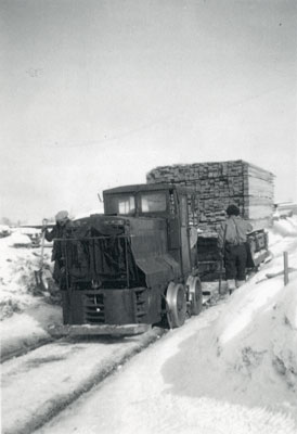Moving Lumber by Railroad with a Pick-Up Truck, circa 1920