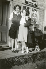 Kate Scarr and Lillian Follick, in front of Scarr's Store, circa 1930