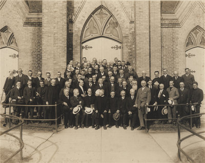 Group of men in front of St. John's Lutheran Church, Waterloo, 1922