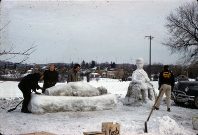 Students building snow sculpture, Waterloo Lutheran University Winter Carnival 1962