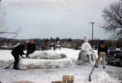 Students building snow sculpture, Waterloo Lutheran University Winter Carnival 1962