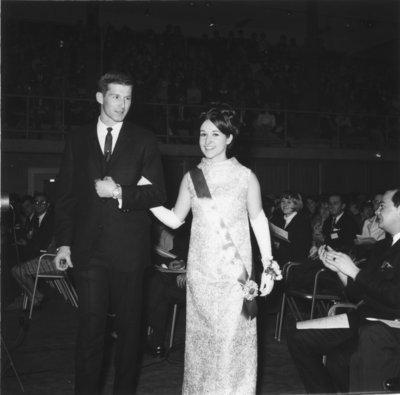 Miss Waterloo Lutheran University 1968 and her escort