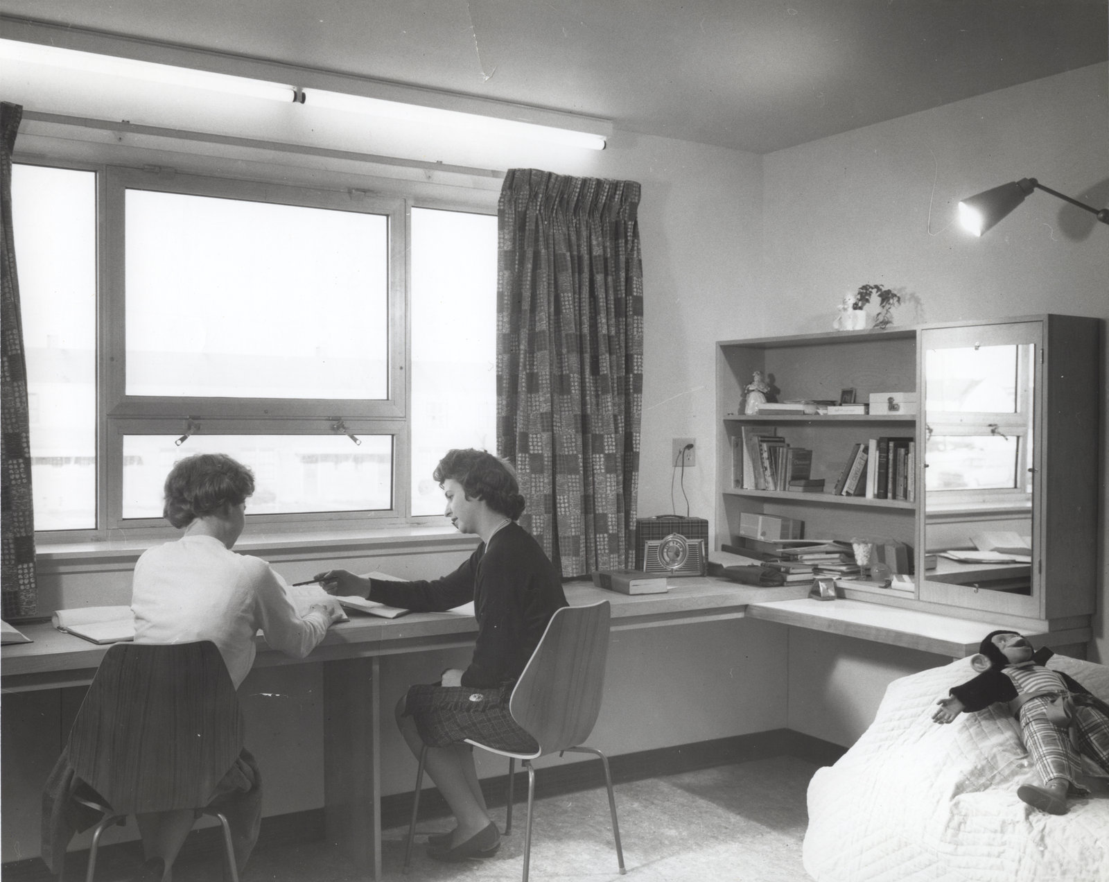 Two women in conrad hall waterloo lutheran university for Clara house