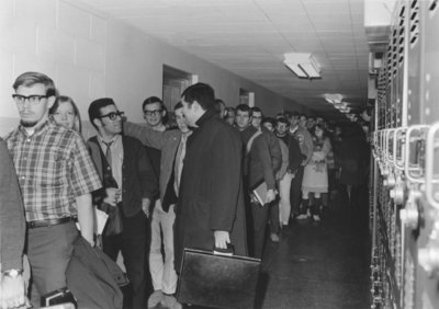 People standing in line for Winter Carnival tickets, 1968
