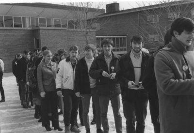 Waterloo Lutheran University student standing in line at Winter Carnival 1970