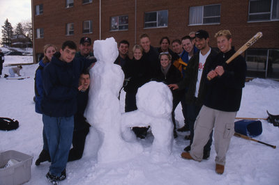 Students with snow sculpture, Wilfrid Laurier University Winter Carnival 1999