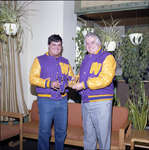 Glenn Carroll receiving Lettermen's Club jacket