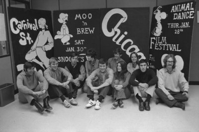 Students in front of Winter Carnival 1971 advertising board