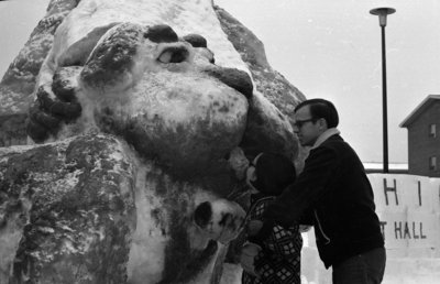 Students looking at snow sculpture at Waterloo Lutheran University Winter Carnival 1968
