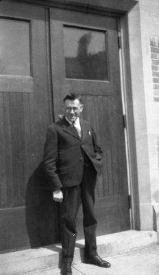 Man standing in front of Willison Hall doorway