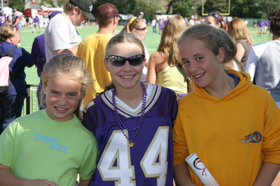 Three children at the Wilfrid Laurier University Homecoming football game, 2005