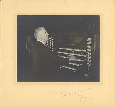 R. G.  Geen playing organ in Moose Jaw, 1958