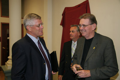Max Blouw speaking to a man at a Laurier Brantford event