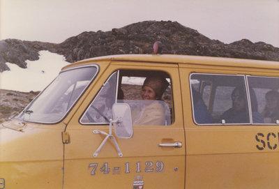 Marie Sanderson driving a van in Nunavut