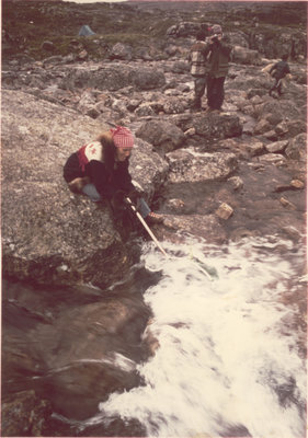 Marie Sanderson collecting water samples