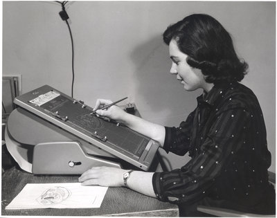 Waterloo College student using office equipment