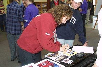 Cheryl Pounder signing photographs