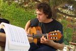 Student playing the guitar on campus, 2003