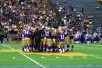 Football team huddle, Wilfrid Laurier University Homecoming game, 2003