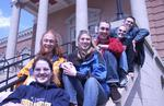 Students sitting on steps of Carnegie Building, 2002