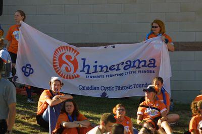Students holding Shinerama banner Orientation Week, 2001