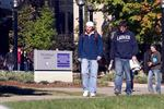 Two students walking on campus, fall 2004