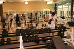 Students using weights at Athletic Complex, 2006