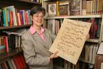 Alma Santosuosso holding medieval sheet music, 2005