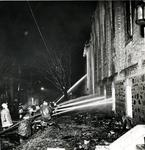 Fire fighters using hoses at St. John's Lutheran Church, Waterloo, Ontario