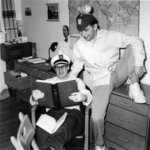 Two Waterloo College students reading a book in dormitory room