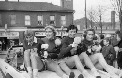 Waterloo College cheerleaders in Homecoming Parade, 1957