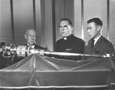 Three men with Waterloo Lutheran University mace