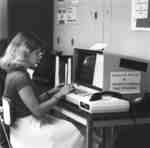Wilfrid Laurier University Library staff member using computer