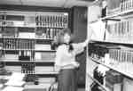 Malle Finney working in the Wilfrid Laurier University Library