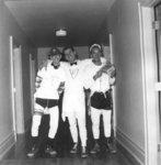 Three men standing in hallway, Waterloo College