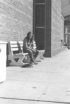 Woman sitting on a bench, Waterloo Lutheran University