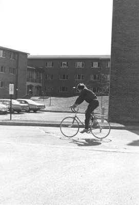 Man riding a bicycle, Waterloo Lutheran University