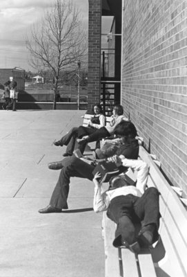 Students on benches, Waterloo Lutheran University